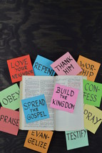open Bible, spread the gospel, build the kingdom, testify, pray, confession, love your neighbor, repent, worship, thank him, repent, evangelize, praise, obey, words, paper, lettering