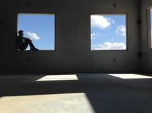 A man sitting in a window