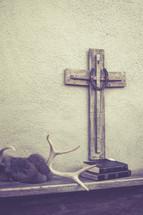 cross, Bibles, and elk horns