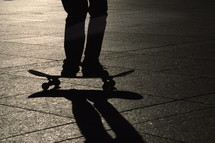 skater jumping on his skateboard with his shadow in evening backlight. backlight, frontlightning, contre-jour, sport, sports, skateboard, skater, skating, joy, fun, happy, young, teens, teenager, jump, jumping, board, shadow, evening, flying, fly, acrobat