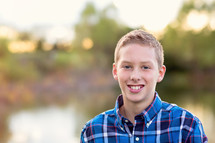 portrait of a teen boy outdoors