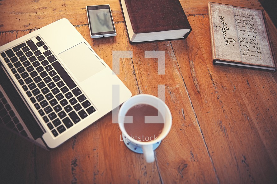 laptop, computer, wood floor, wood table, open Bible, Bible, journal, cup, cellphone