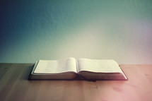 open Bible on a wood table