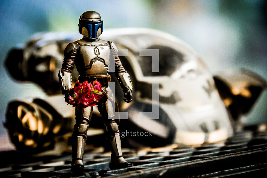 robot toy holding flowers