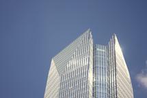 top of a skyscraper in a blue sky