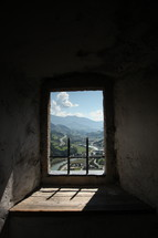 view of mountains through a window opening