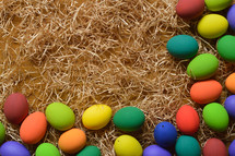 border of easter eggs in straw