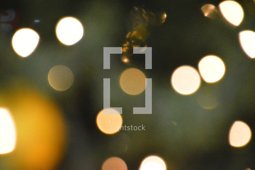Christmas tree bokeh for Christmas in yellow, white and green. 
