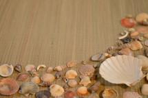seashell border on a straw mat