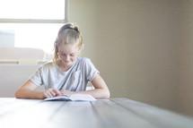 a girl reading a Bible
