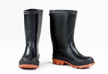 A pair of black rubber rain boots.