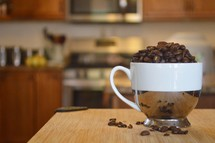 coffee cup filled with coffee beans in a kitchen