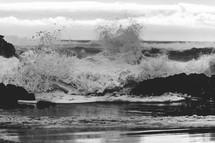 powerful wave crashing into rocks