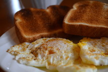 toast and eggs on a plate