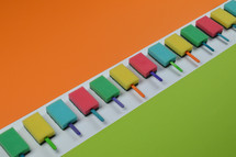 colorful row out of self made, crafted sponge popsicles between green and orange paper as thank you for the volunteer cleaning team in church or as decoration for the vacation bible school in the classroom