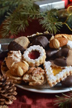 christmas cookies on a plate with christmas decoration.  Christmas, gingerbread, cookies, cookie, biscuit, delicious, tasty, yummy, delicate, colorful, colourful, multicolored, bake, baking, eating, food, bakery, bakeshop, variety, diversity, richness, nibble, snack, sweets, sweet, pastry, goods, pastries, groceries, edible, eatable, consume, cinnamon, nut, macaroons, marzipan, jam, marmalade, jelly, cooky, chocolate, nougat, choice, selection, assortment, goodies, abundance, plenty, opulence, tradition, self made, handmade, baked, fresh, sugar, icing sugar, powdered sugar, dough, breadboard, bread-board, bread board, biscuits, almond, season, Christmas time, Christmastide, cut out, butter, cut, vanilla crescents, heart, hearts, fir tree, fir trees, walnut, hazelnut, coconut, advent, sharing, friend, friends, hand, hands, take, taking, different, various, divergent, diverse, varied, differing, variable, shape, shapes, kind, sort, plate, give, giving, present, offer, offering, hospitality, invitation, party, joy, celebration, eat, festivity, guest, guests, guest-friendship, invite, see, come, visit, gift, homemade, home made, home-made, self, self-made, celebrate, celebrating, feast, enjoy, relish, savor, savour, appreciate, pick, help oneself, help yourself, empty, full, prepare, preparing, dress, dressing, serve, serving, food arrangement, arrange, arranging, decorate, decorating