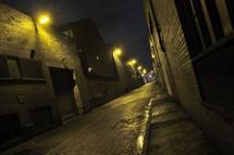 Dimly lit alley at night.