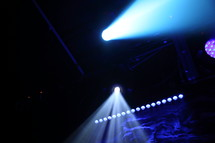 spotlight above a stage