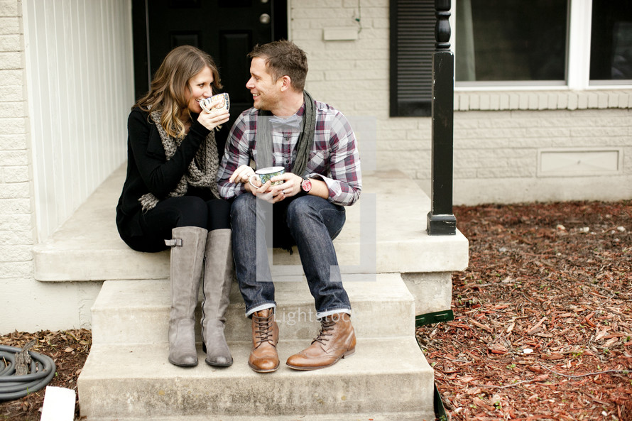 couple drinking coffee on their front porch