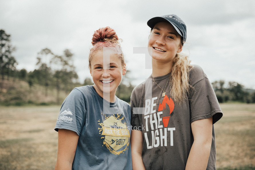 smiling young women on a mission trip
