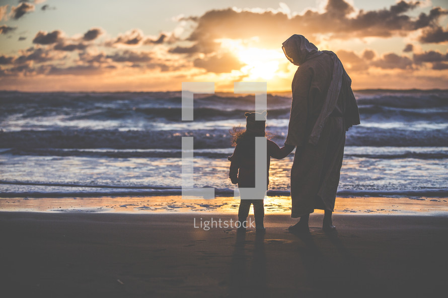 Jesus holding hands with a little girl on a beach