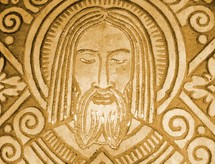 A stone carving relief of Jesus Christ from a Mayan art carving.