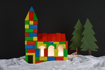 church built out of multicolored different wooden toy blocks as symbol for the community of believers