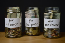 Savings jars full of money for mission, for the poor, and for our church