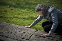 grieving woman at a grave site