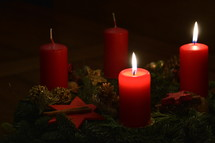 Two candles are burning at the Advent wreath for the second advent.