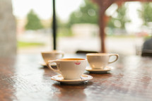 coffee cups in saucers