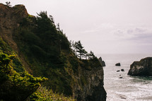 rock formations and cliffs along a shore