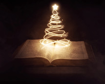 Christmas tree of lights and the pages of a Bible