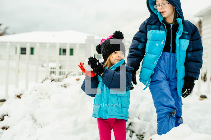 kids throwing snow balls