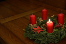 One candle is burning at the Advent wreath for the first advent.  advent, candle, Christmas, candles, four, three, two, one, lit, light, bright, burn, burning, wreath, birth, Jesus, born, waiting, wait, flame, flames, red, arrive, arriving, come, coming, await, await arrival, arrival, anticipated, anticipate, anticipating, expected, expect, expecting, awaited, long-awaited, hope, hoping, desiderated, longed, longed for, long-yearned-for, crave, desire, long, desiderate, longing, craving, desiring, fir, fir branch, branch, fir-bough, cone, fir cone, pine, pine cone, quiet, time, Christmas story, nativity, nativity story, countdown, count, first, first advent