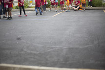 children outdoors in a parking lot