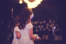 flower girls at an evening wedding