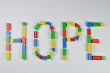 word hope of colorful toy wooden blocks