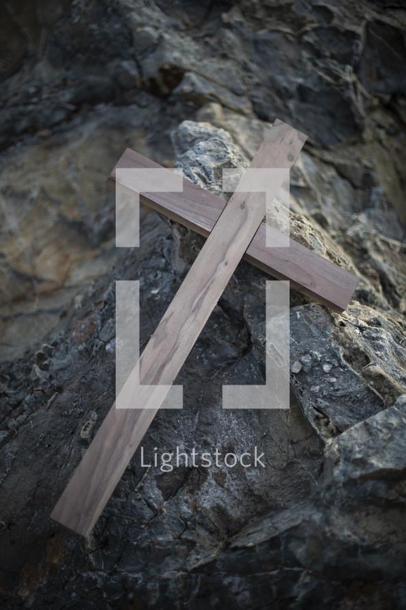 wooden cross on a rock