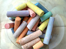 Pastel colored chalk with yellow, purple, green, pink, mauve, peach and other pastel colors to be used by an artist, children in school or creative professional to create a work of art in pastels used in art class, art education or a basic drawing course.