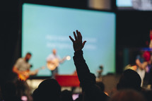 raised hands in a congregation at church