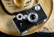 vintage camera on a straw hat