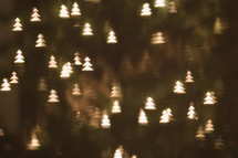 tree shaped bokeh white lights on a Christmas tree