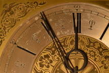 five minutes before twelve o'clock at a ancient golden clock.   late, last minute, scarce, high time, waste, wasting, New Year, clock, watch, year, new, New Year's Day, come, coming, go, going, gone, fading, fleeting, ephemeral, evanescent, time, sliding, fade, slide, New Year's Eve, eve, future, past,  period, era, age, aging, temporary, present, moment, currently, view, prospect, outlook, perspective, vista, lookout, forecast, sluice, briefly, brief, momentary, short-duration, short-period, short-term, short-time, day, date, number, numeral, index, annual, annually, yearly, turn, turn of the year, gold, golden, change, changed, changing, season, seasons, vanish, pass, timepiece, timekeeper, horologe, timepieces, hour, minute, second, hours, minutes, seconds, ticking, tick, chronometry, timing, timer, timers, clockhand, hand, pointers, clock-hand, big hand, little hand, minute hand,  round, circular, circle, circles, orbital, old, ancient, antique