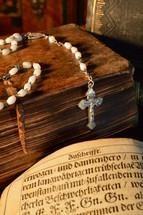 rosary on an old Bible