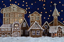 home made gingerbread town with bokeh sky out of blue velvet and christmaslights