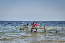 children on a pier