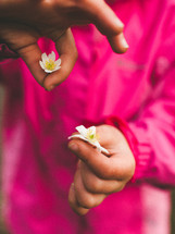 a child holding flowers