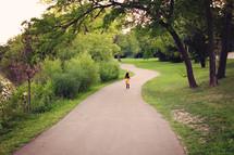 little girl walking on a path