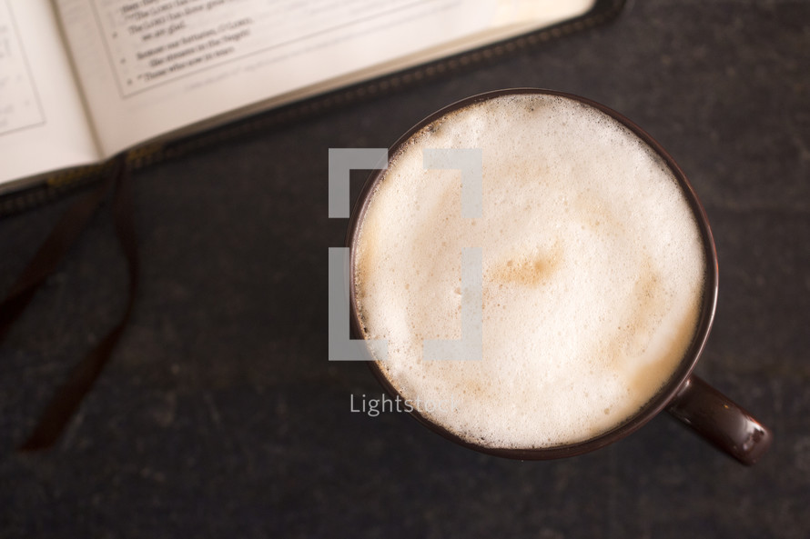 latte and Bible on a slate table